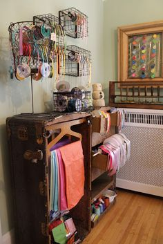 Finally, something to do with this sucker... -  Vintage steam trunk used as organizer. Wire baskets become ribbon display/ holders. Salvaged picture frame and chicken wire used as decorative paint and paintbrush holder.