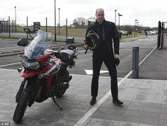 Action man:The Duke of Cambridge, 35, donned a leather riding suit and helmet as he test drove the latest Triumph Tiger 1200 on Tuesday