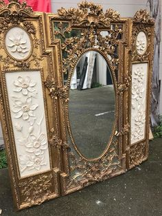 """Beautiful three panel screen with mirror in the middle panel centered with an oval mirror. Great details throughout with a floral design. Measures approx. 72"""" H x 66""""W"""