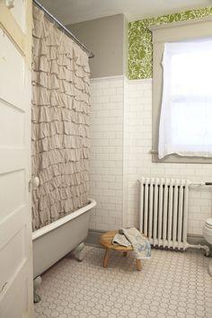 Subway tile. White. Grey. Green. Ruffles. Old school radiator.  I'll take this bathroom to go, please.
