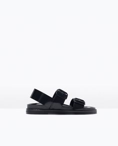 BUCKLED SANDALS WITH FOOTBED