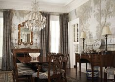 dining room in deep brown, gold, & dusty blue; tree mural wall