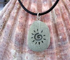 The Primitive Sun - deeply Engraved upcycled Beach Stone Pendant