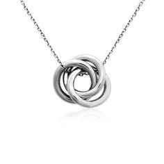 Crafted with stylish sophistication, this sterling silver pendant features hollow, lightweight rings intertwined on a matching cable chain.