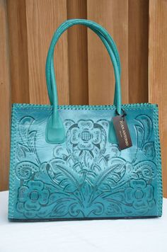 Juan Antonio turquoise leather purse