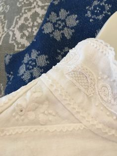 White linen embroidery on linen fabric. Blue fabric is hand woven fabric for the vest and grey fabric is handwoven for apron. Trønderbunad. Made by Mona Øvregård in Bunadsystua Liv Laga.