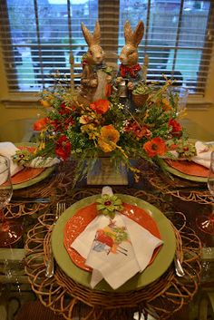 Pier 1 dishes, napkin rings, and placemats for an Easter tabletop