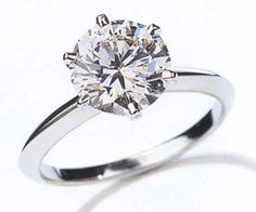 Repin this if you would love a simple round solitaire diamond engagement ring! www.twobylondon.com