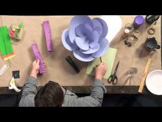 Robert Mahar teaches you how to make giant paper flowers. http://cr8.lv/1l1zvFy  Paper flowers make great party decoration and can be made from basic colorf...