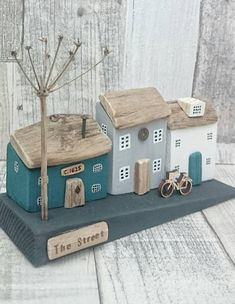 THE STREET Handcrafted original artwork by DriftwoodSails This wood sculpture depicts a street scene of neighbouring houses, including the old cottage at the top of the hill that is nearly 400 years old! Lovingly hand-crafted using salvaged wood, natural driftwood, chalk paints,