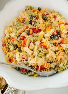 My favorite pasta salad recipe...passed on through our family.  It is both light (no mayo) and fresh (lots of yummy veggies and Parmesan cheese!)