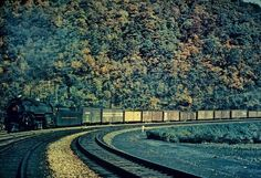 PRR J-1A, 2-10-4 locomotive pulling a westbound mixed-cargo freight train at 15 MPH at the Horseshoe Curve during the Summer of 1948.