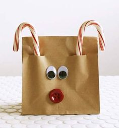 cute reindeer bags- maybe put a packet of hot cocoa mix inside and let the kids give to their friends for Christmas...