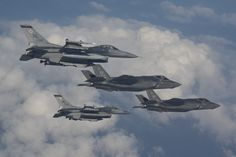 F-16s from Hill Air Force Base fly next to the F-35A Lightning II, the Air Force's newest fighter jet, in a training mission at Eglin AFB, Fla., 4/25/2014 . Hill AFB is slated to receive its first operational F-35s in the fall of 2015. (U.S. Air Force photo/Staff Sgt. Katerina Slivinske)