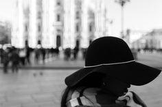 Milan - A girl walking in Duomo Square, Milan for shopping