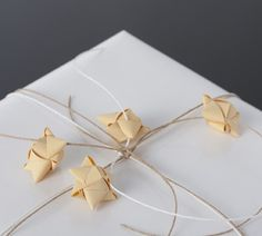 Handmade Paper Stars by Stjernestunder and some Paper Twine for an elegant gift wrapping