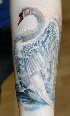 lovely_white_swan_tattoo_on_arm.jpg.pagespeed.ce.QlrwYBgrGk.jpg 424×700 pixels