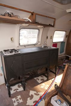 Dierks Bentley's Airstream Trailer, The credenza has been converted into a kitchen counter, complete with a two-burner stove and sink. The Gypsies painted it black, but it's still not in its final form.