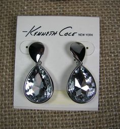 These fabulous earrings feature a large crystal teardrop dangling from a smaller silver tone inverted teardrop. Very elegant...perfect for the holidays or any time you just want to feel fabulous!
