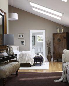 Modern Bedroom Design #bedroom #modern #interior #design #slanted #ceiling #bed #neutral #colors #lounge #casual #skylighting
