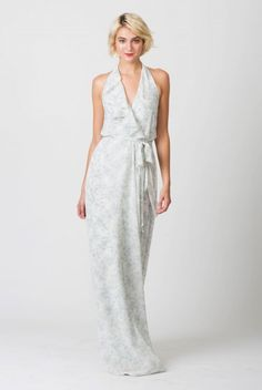 Asymmetrical bridesmaids dress with ruffle halter and mock wrap skirt from Nouvelle Amsale Bridesmaids. Shown in Cloud.