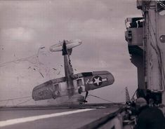 Vought F4U Corsair crashes on the deck of a carrier when the arresting gear failed. Most likely sometime during WW2 in the Pacific Theater.