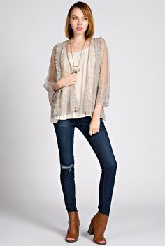 This sheer cardigan is an adorable addition to your fall style. The lace detail and embroidered design make this cardigan an easy way to add a chic touch to your look!