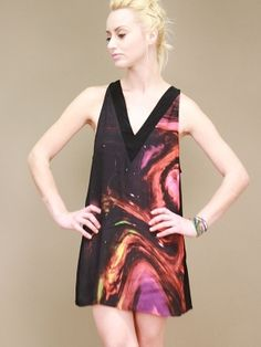black, A-line tank dress with vibrant space galaxy print by Motel  | For more great pins, please follow me at www.pinterest.com/oliviabbradley