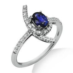 This beautiful ring features a lovely 0.64ct oval shaped sapphire surrounded by brilliant round cut diamonds in a 18k white gold prong setting. The color of the diamonds are G/H and the clarity is SI1/SI2.Different ring sizes may be available. Please inquire for details. $431.00