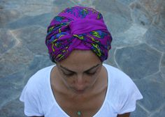 3. Voila, you've just made a turban! You can also create a turban-like headband using a rectangular scarf by repeating the same steps without covering all of your hair. Don't forget the double twist and happy wrapping!