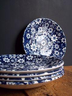 Prettily-patterned vintage plates make even a simple meal memorable.