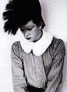 Steve Strange circa 'mind of a toy' with his huge crimped head of hair and creative make-up.