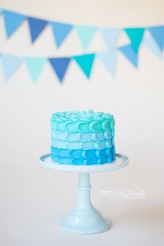 "Aqua, water, waves for ""The Big One"" cake"