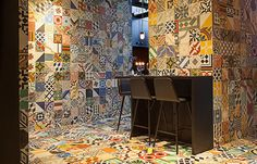 Brightly-coloured patterned ceramic tiles line the walls, floor and stairs of this South American restaurant in Copenhagen