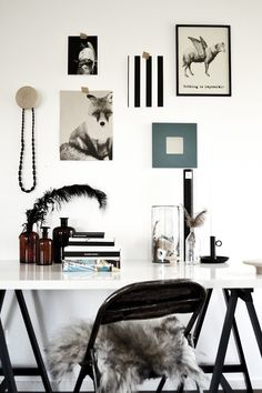 If I could ever possibly work in a tidy art studio, his is what I'd like it to look like...but with personalised stimulus in those picture frames that I could replace and change regularly to suit the project in progress. Love that soft, curly, black feather. Totes want to rub it all over my face! :)