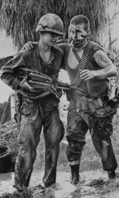 Vietnam War wounded soldier being helped by another soldier.  Year unknown. Look how young they were and then they were treated like crap by alot of americans when they came home