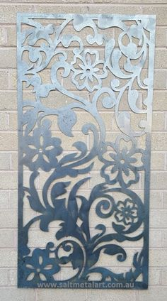 Garden art decorative panel flower vine design great as privacy screen or wall hanging. decor supplied raw or flat black.