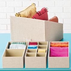 The Container Store > Linen Drawer Organizers. :)