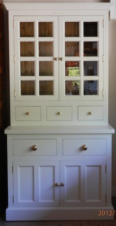 Keep your kitchen dresser traditionally stylish with a white hand painted finish and brass knobs.