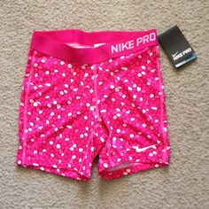 """NIKE 3"""" PRO ALLOVER PRINT GIRLS' SHORTS XL DriFIT fabric helps keep you dry and comfortable. Ergonomic seams and stretch fabric for enhanced range of motion. Flat seams move smoothly against your skin. Tight fit is ideal for layering and offers support Product Details Elastic waistband. 3 inseam based on size medium. Fabric Body DriFIT. 92 polyester 8 spandex. Gusset lining. DriFIT 100 polyester. Machine wash. Nike Shorts"""