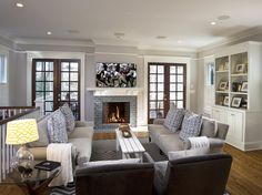 Cottage Living Room with Landon upholstered sofa, Casement, brick fireplace, Standard height, Fireplace, French doors, Paint