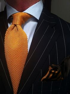 This is the proper way to mix patterns. WIWT Navy pinstripe Blue Label suit by Ralph Lauren, MTM micro check shirt by Van Laack fitted by Lowet Tailors, orange knit tie and silk pocket square both by Tom Ford