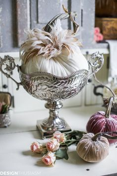If you're looking for ideas for introducing early fall decor into your home, consider these tips using neutral pumpkins styled in a hutch.