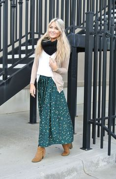Stay comfy and warm by wearing your maxi with a slim cardigan and a scarf. Heeled booties keep this look from being too casual.
