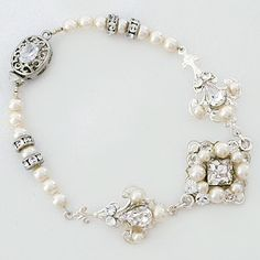 Cheryl King Couture Bridal Jewelry.  Delicate filigree designs are adorned with crystals & ivory pearls, creating a bridal bracelet with vintage charm.