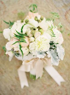 I love the color of the ribbon - pale blush or ivory satin. I would like the ribbon tied around the bouquet though, with no extra ribbon hanging down.