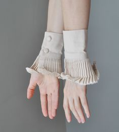 Ruffle detail cuffs - like the idea of creating these to wear underneath sweaters etc so it looks like you have layers without the baulk on the body. Image Fashion, Fashion Details, Fashion Design, Fashion Fashion, Fashion Trends, Faux Col, Fabric Manipulation, Collar And Cuff, Sleeve Designs