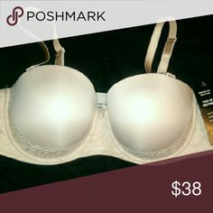 Torrid Nude Push-up Multiway bra 40D This versatile nude microfiber bra has a super-supportive wider band that keeps the bra smooth and comfortable on your skin - even without the straps. Trimmed with flirty lace, and finished with no-slip silicone piping for confident, worry-free wear. Wear strapless, classic, crossback, halter and asymmetrical torrid Intimates & Sleepwear Bras