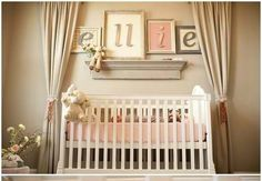 Neutral colors, framed letters, curtains to frame the bed. Love!