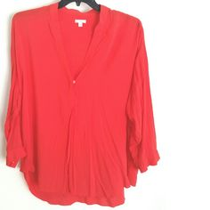 """Gap XXL Long Sleeve Split Neck Fiery Red Rayon Top This Gap XXL Long Sleeve Split Neck Fiery Red Rayon Top is in great used condition. Worn once. Bust measures 27"""" across laying flat, measured from pit to pit, so 54"""" around. 28"""" long in front, 32"""" in back. Has a teeny bit of stretch. ::: Bundle 3+ items from my closet and save 30% off when you use the app's Bundle feature! ::: No trades. GAP Tops Blouses"""